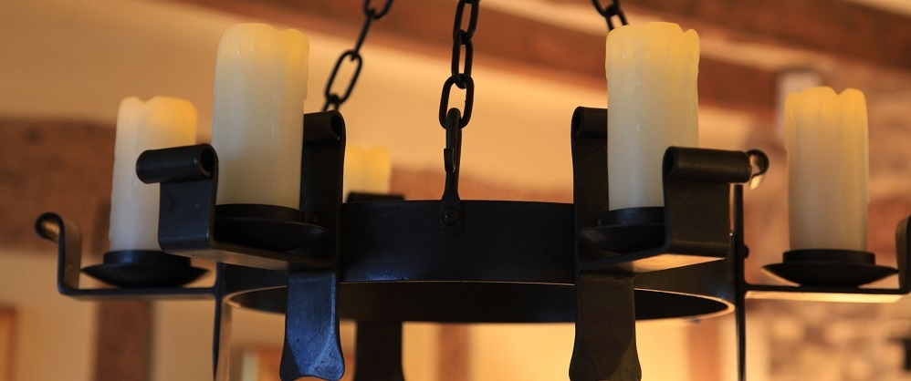 Candle-light for our wrought iron chandeliers and wall lights