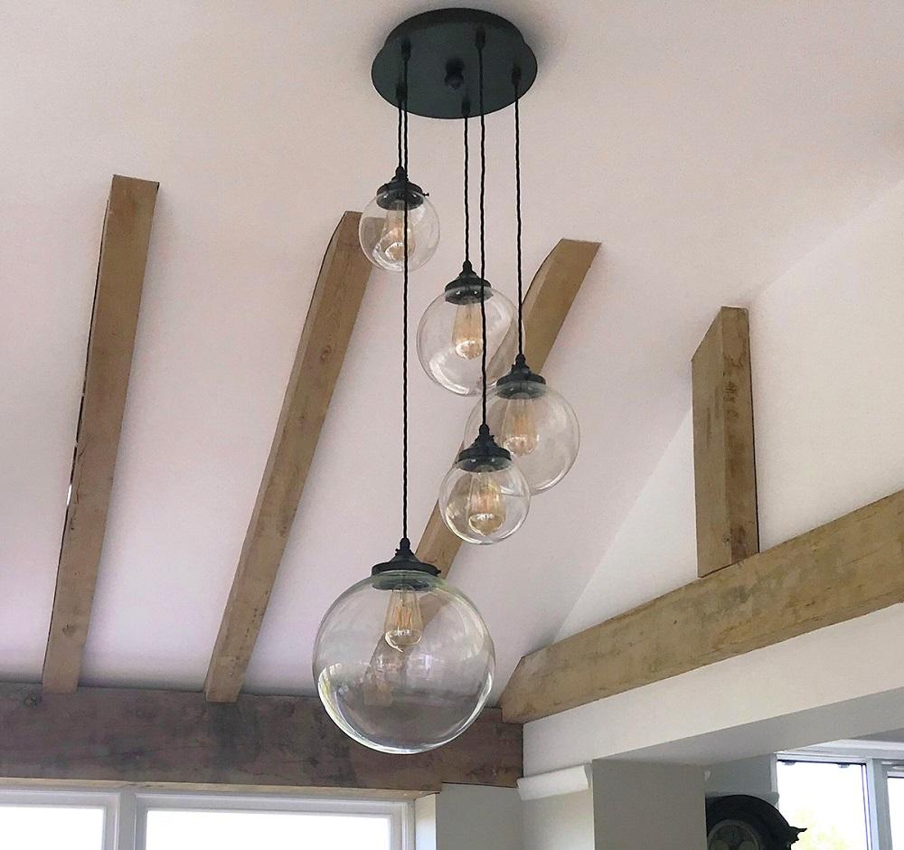Ceiling lights by Nigel Tyas Ironwork - Broadstones