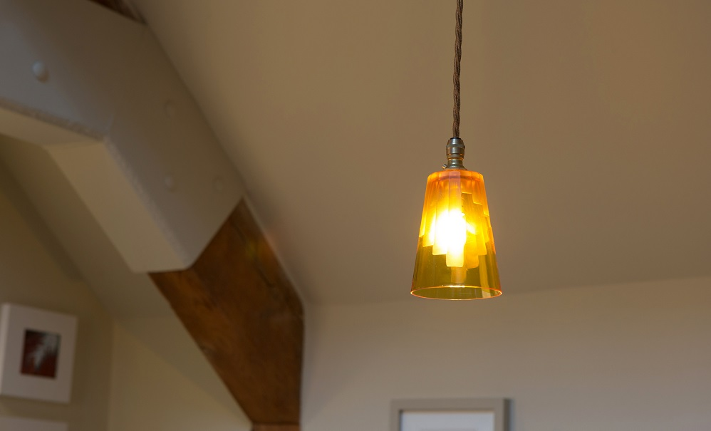 Our Cobcar pendant with amber 24 lead crystal shade