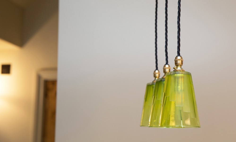 Our Cobcar 3-light pendant with lime green shades