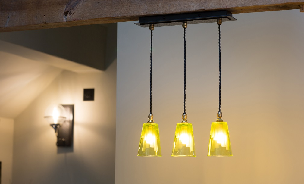 Our Cobcar three-light pendant with handforged ceiling plate